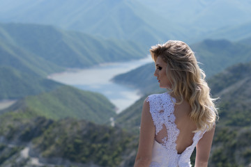 Bride in the mountains. The concept of lifestyle and wedding.