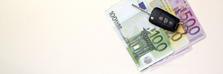 Euro banknotes and new car keys.Conceptual image for finance or business.Lot of copy space