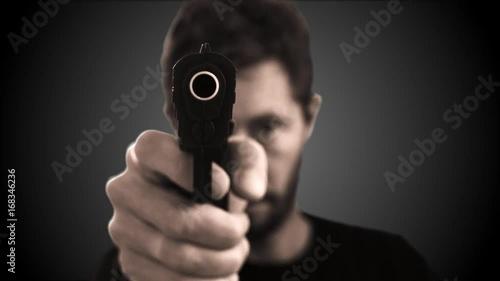 gun pointing at camera