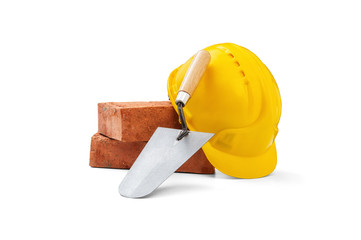 Trowel, bricks and helmet