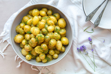Potato salad with curry sauce and herbs