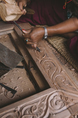 Carving a wooden door frame.