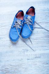 Men's sneakers on a wooden background