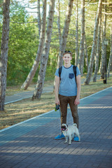Young man with a pug in the park