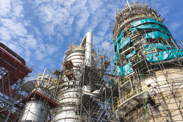 worker work on scaffolding for install refinery plant