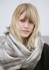 Portrait of a young woman wearing a cool scarf