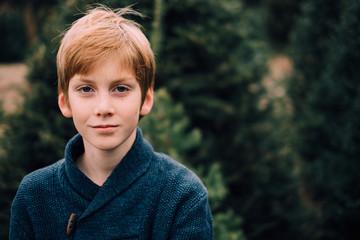 redhead teen in christmas tree farm