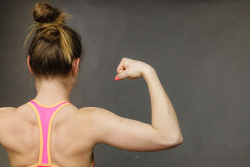 Woman showing muscles of the back and shoulders