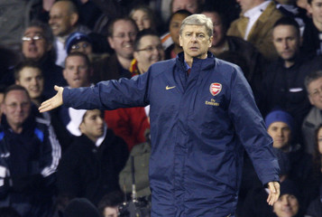 Arsenal manager Wenger reacts during their English Carling Cup semi final second-leg soccer match defeat to Tottenham Hotspur in London