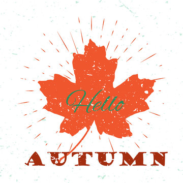 Hello autumn lettering typography on red maple leaf with burst on a old textured background. Hand drawn trendy design for a logo, greeting cards, invitations, posters, prints, banners, t-shirts