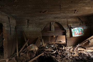 A wall painting is seen on a wall of a room filled with debris and mud after a flash flood at Pentagon, in Freetown