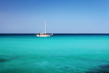 sailboat in the blue water
