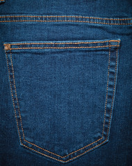 The texture of the jeans pocket is close-up.