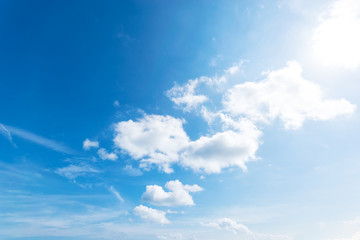 Blue sky background with the sun,Blue sky with white clouds floating in the sky.