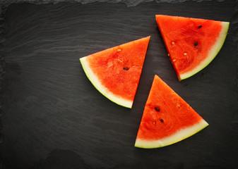 Image of fresh sliced watermelon on slate stone plate