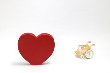 介護イメージ 車椅子 ハートマーク