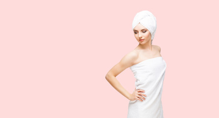 Young, beautiful and natural woman in towel. Spa concept with copyspace.