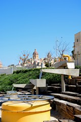View of waterfront buildings with a modern fountain in the foreground, Vittoriosa (Birgu), Malta.
