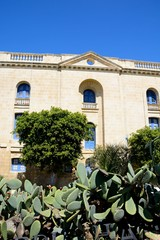 View of the side of the Malta maritime museum with prickly pear cactus in the foreground, Vittoriosa, Malta.