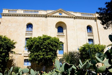 View of the side of the Malta maritime museum with prickly pear cactus in the foreground, Vittoriosa (Birgu), Malta.