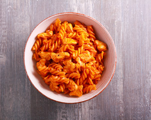 Chicken breast and pasta in tomato sauce, served