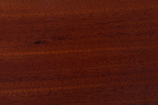 Red wood pattern of the surface.
