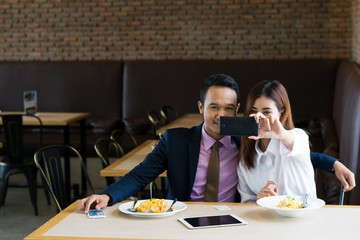 Couple photographed in a restaurant.