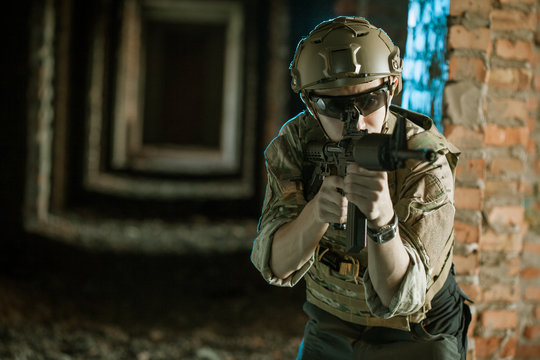 airsoft soldier with a rifle playing strikeball In brick building