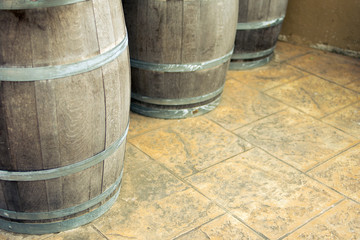 wine fermentation,Old wooden barrels and tanks for processing wine