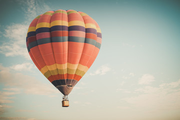 Vintage hot air balloon flying on sky. travel and air transportation concept -vintage and retro filter effect style