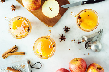 Making Hot Mulled Apple Cider with Cinnamon, Nutmeg, Cloves, and Star Anise Spices