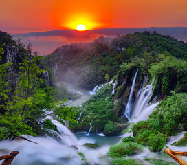 Poster Waterfalls sunrise over the waterfall in Plitvice ,Croatia
