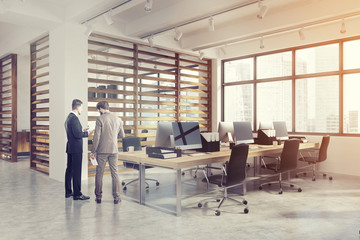 Open office interior with plank walls, men