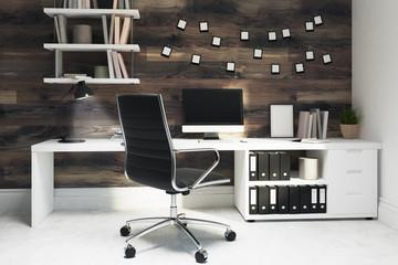 Dark wooden home office, black chair
