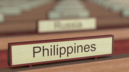Philippines name sign among different countries plaques at international organization. 3D rendering