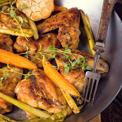 Grilled chicken wings with caramelized carrots