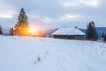 wonderful winter scenery with snow and timber home