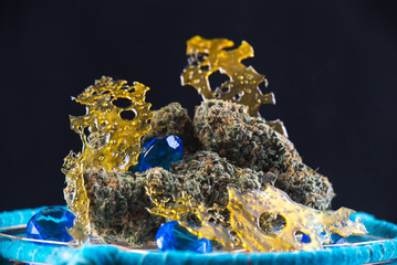 cannabis nugs and marijuana concentrates (aka shatter) with smoke isolated