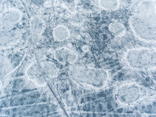 Aerial top down view over icy lake surface pattern, near Latazeris village. Winter season in Lithuania.