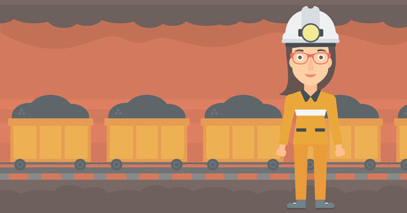 A woman in hardhat with torch on the background of mining tunnel with cart full of coal vector flat design illustration. Horizontal layout.