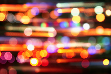 image of colorful blurred defocused bokeh Lights. motion and nightlife concept