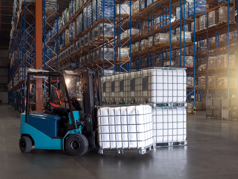Containers for solvent are handling by forklift to storage in the warehouse and factory,plastic storage drum