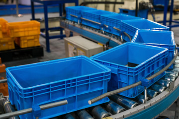 Plastic box on roller line for tranfer production part in prodine lin in factory