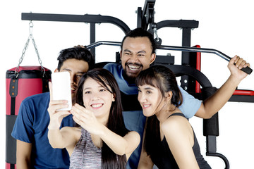 Diverse people take selfie picture together