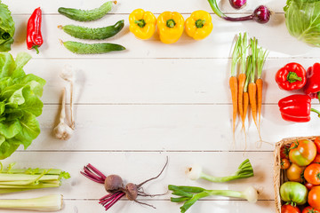 Frame of fresh organic vegetables on wood background. Healthy natural food on rustic wooden table with copy space. cooking ingredients top view