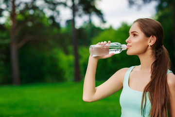 Woman drink from a water bottle, outdoor