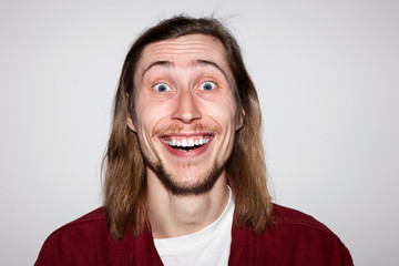 Positive astonishment. Surprised young male. Happy and good news for man, handsome guy portrait, facial expression concept