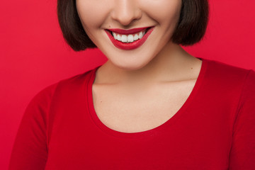 Stomatology advertising. Female with white teeth. Unrecognizable woman with wide smile and red lipstick closeup, oral health care, dental concept