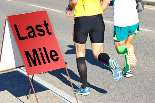 Two runners are running the last mile - concept image