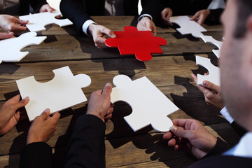 Business people and puzzle